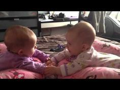 Two identical twin girls are finally realizing they can talk to each other as well as hold hands. How sweet is that? Such a precious moment. Credit to 'anpsq...