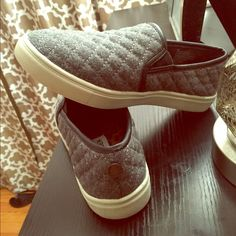 Steve Madden Gray Slip On Sneakers Super cute and popular slip on sneakers. Gray quilt patterned, worn maybe three times the most. Excellent condition, like new. They're size 4, witch also fits a size 6- 61/2 in women's .  Steve Madden Shoes Sneakers