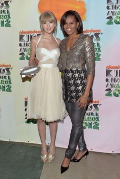 Taylor Swift - Kids' Choice Awards 2012(March 31).First Lady Michelle Obama presented her with this year's The Big Help Award at that night.