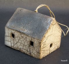 Rowboat's ceramic houses and sheds are part glazed and raku fired.     These can be supplied strung with hemp string for hanging – please specify when ordering.     All pieces are hand made and hand fired, so they will vary in shape and colour.     Approximate size:     houses:  height 5-7 cms