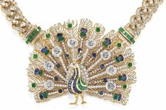A DIAMOND, SAPPHIRE AND EMERALD PEACOCK NECKLACE, BY WILM