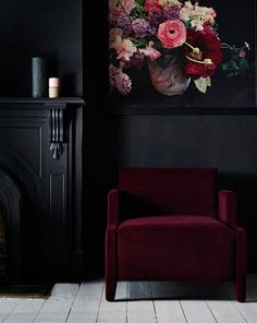 Beautiful, unique corner featuring black walls, black traditional fireplace, burgundy velvet accent chair and inky artwork on the wall | Photo by Mike Baker, Styling by Heather Nette King