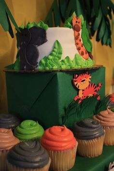 Smash cake and cupcake stand with jungle animal smash cake. Cake And Cupcake Stand, Cupcake Cakes, First Birthday Parties, First Birthdays, Personalized Water Bottle Labels, Jungle Theme Birthday, Jungle Animals, Cake Smash, Streamers