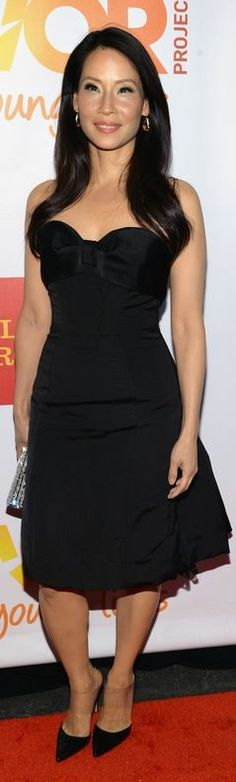 Who made  Lucy Liu's black bow dress, crystal clutch handbag, and pumps that she wore in New York on June 16, 2014