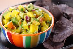Avocado and Mango Salsa - A light and colorful party dish with chips. The combination of flavors, sweet and salty with tangy hint of lime makes this a winner. This is also great over grilled fish or chicken!