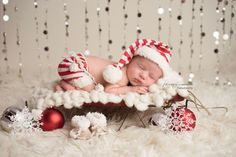 The cutest red and white striped jersey knit skirt, beanie, and/or tieback! The skirt has ties with adorable pom poms! Plus, check out the adorable Sherpa and suede baby boots!! Newborn and baby photography props by No. 2 Willow Lane. Christmas props. Santa set. Image by @Photography by Axsys Design