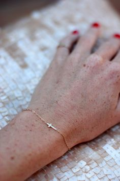 @couldihavethat? has  been switching out her chunky chains for this dainty mini cross bracelet by @Jennifer Fisher Jewelry.