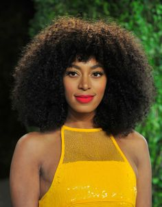 This matte tangerine lipstick borders on caution-cone territory, but it blends in perfectly with Solange Knowles's mustard gown.