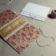 http://www.ardeas.sk/ sewing journal / leather & paper / handmade bookbinding / long stitch - french binding over leather