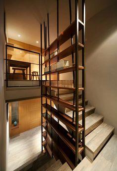 Encore une belle idée de rangement combiné à un escalier