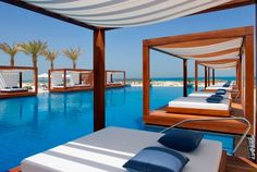 Abu Dhabi's luxury Monte Carlo Beach Club, how comfortable do the daybeds look #sunprotection #holidays