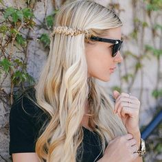 A half-up hairstyle featuring a snake braid.