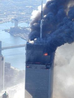 9/11 World Trade Center Attack - This image never seems to get old, and always reminds me of that day.