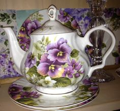 Lovely pansy teapot. We have lots of teapots in our shop. Check us out online at teapots4u.com or brainbrews.com