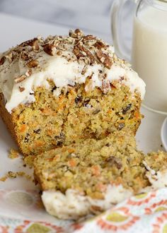 Start your holiday baking with this Frosted Carrot Cake Loaf. Loaded with pecans, grated carrots and raisins and topped with homemade cream cheese frosting. Carrot Cake Loaf, Carrot Cake Cheesecake, Moist Carrot Cakes, Gluten Free Cheesecake, Carrot Cake Cupcakes, Vegan Carrot Cakes, Loaf Cake, Loaf Recipes, Whole Food Recipes