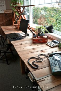 @Donna - Funky Junk Interiors' reclaimed lumber farm table styled desk is something we'd love to have in our own office!