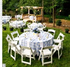 tables covered in blue-and-white gingham print tablecloths and surrounded by white wooden folding chairs. Makes it look sweet country not to much like a picnic