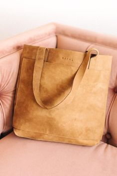 **Bohme Exclusive** This exclusive tote bag is made of genuine leather that is both durable and stylish! With a small embroidered Bohme on it, this bag is high quality and features a large outside pocket and two inside pockets. Minimalist Bag, Diy Purse, Leather Projects, Leather Crafts, Leather Bags Handmade, One Bag, Casual Bags, Small Bags, Tan Leather