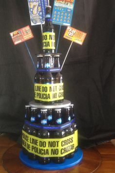 "I made this police themed ""beer cake"" for my husband for his birthday.  You can guess, of course, that he's an officer, and on his days off, likes to enjoy a beer or two, and some lotto scratchers."