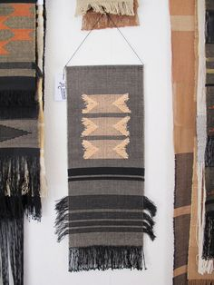 Handwoven wall hanging Mounted on an aluminium tube and a waxed cotton cord  Black cotton, sand, salmon pink & black linen  8.5 by 23 inches    Unique