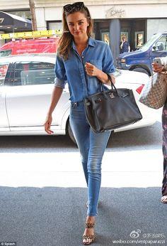 Miranda Kerr wearing 7 For All Mankind The Skinny in Light Cobalt Blue MIU MIU Leopard-print calf hair mules Hermes Birkin Bag in Black