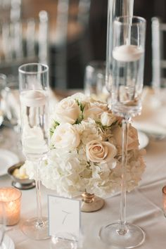 floating candles, low centerpieces with roses, hydrangeas and spray roses