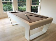 """The elegantly curved billiard table""""247 Billiards""""made of Corian® exudes a fascinating touch of luxury."""