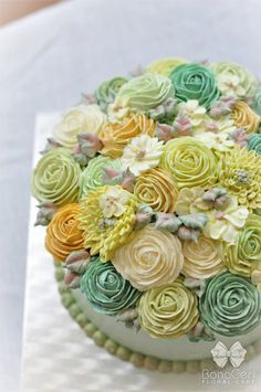 Layering on the flowers in a cake like this, as well as the gradient buttercream.