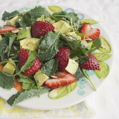 Baby Kale Salad with Strawberries and Avocado with a Lemon Vinaigrette…this salad is super healthy, but all you'll notice is that it's super delicious! :)