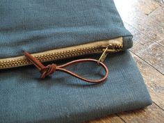 Fold-over clutch with metal zipper.  Good instructions on installing a zipper.