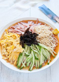 Hiyashi chūka (cold ramen) is made with cold Chinese-style egg noodles, with sweet vinegar sauce and topped with vegetables, egg and ham.