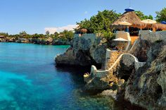 Island Outpost - Exclusive Boutique Hotels & Villas in Jamaica The Caves is an intimate, secluded 10-acre resort set on the island's western coast. Among the 12 cliffside accommodations are one and two bedroom cottages and suites and a four-bedroom deluxe villa, as well as two main dining gazebos, a rum bar, and a spa.