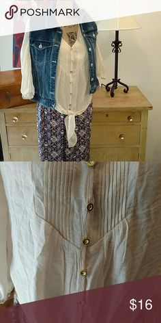 Cream Boutique Button Down Adorable cream button down with gold accent buttons, ties in front, 3/4 sleeves Medium  Excellent condition No trades All reasonable offers accepted Tops Button Down Shirts