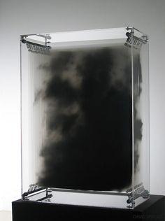 Smoke frozen in a box. Black acrylic paint on transparent film, display case, springs, lighting. Dark Matter (2007)  | DAVID SPRIGGS