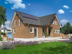 Haus Domizil 192 • Haus mit Einliegerwohnung von Town & Country • Modernes Massivhaus mit Zwerchdach und 192 qm Wohnfläche • Jetzt bei Musterhaus.net informieren!