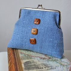 denim blue purse iphone case or cosmetic pouch in burlap fabric with nickel kisslock frame and 3 wooden buttons
