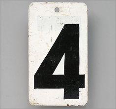 Vintage black & white painted metal marker sign: number '4'