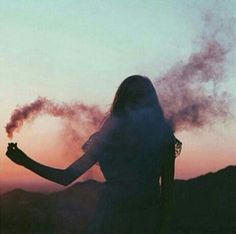 photography with smoke bomb at sunset.
