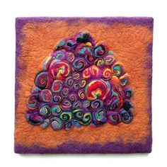 A handmade felt wall piece made of dyed, unspun wool and  yarns, by Sharron Parker.  Abstract, colorful, textural.