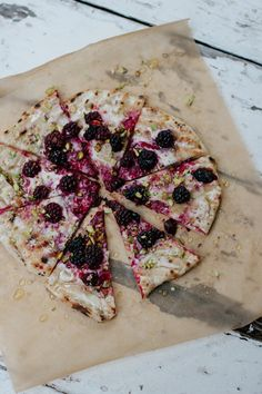 grilled blackberry pizza with goat cheese, pistachios, and honey