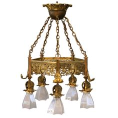 Early 20th Century Brass Chandelier w/Glass Shades   From a unique collection of antique and modern chandeliers and pendants  at http://www.1stdibs.com/furniture/lighting/chandeliers-pendant-lights/