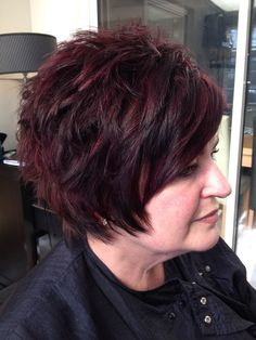 Choppy and lots of texture .....violet / red h/ls with an auburn brown base . HAIR by Martine