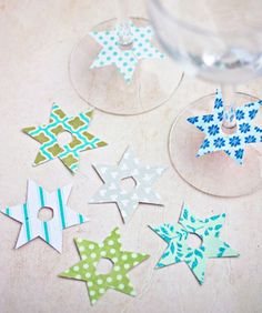 Paper stars to mark stemmed glasses at parties.