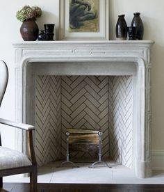 Herringbone tile fireplace.
