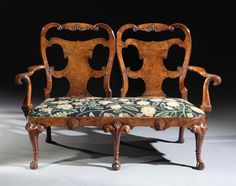 - A rare George I period carved walnut and burr walnut chair-back settee possibly by Thomas How