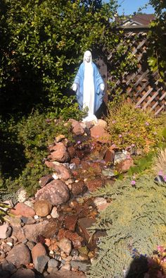 This photo from the garden of James and Patricia M. makes use of a water feature. Not only is water a lovely touch in a yard, but this stream from Our Lady's feet is reminiscent of a grotto spring. Grotto Design, Marian Garden, Prayer Garden, Catholic Company, Home Altar, Altar Decorations, Garden Route, Blessed Virgin Mary, Blessed Mother