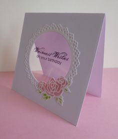 hanndmade card: Warmest Wishes by sistersandie ... clean and simple design ... negative space die cut circle backed with clear acetate ... sentiment stamped with Stazon on the clear panel ... sweet roses die cut roses and lacy frame for the circle ... Stampin' Up!