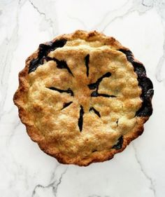 Simple and classic, this fruit-filled pie is bursting with plump, ripe berries. Just fill a dough-lined pie pan with a mixture of blueberries, cornstarch, lemon juice, salt, and sugar. Then, top with a second piecrust and seal before baking. For best results, let the pie stand for at least two hours before serving.