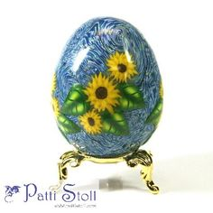 """By Patti Stoll, 2005, polymer clay covered egg, Sunflowers, with Sky inspired by Van Gogh's """"Starry Night"""""""