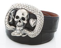 Belt Buckle-Snake and Skull. This is a fantastic and hefty handmade Sterling Silver belt buckle cast using the traditional lost-wax process. A beautifully sculpted skull is framed by a stylized snake with a dagger and heart to either side.